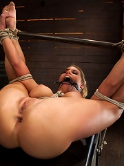 Sexy blond bomb shell whuge tits, is anally penetrated, nipple tortured, made to squirt & cum!